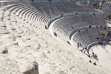 pius: Amman, Jordan - April 03, 2015: View of the Roman Theater in downtown. The theater was built the reign of Antonius Pius 138-161 CE. The structure could seat about 6,000 people. Editorial