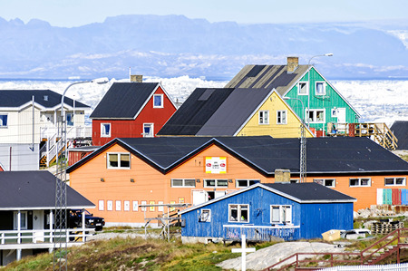 icefjord: Ilulissat, Greenland - August 18, 2012: View of the colorful building of Ilulissat. Located 350 km north of the Arctic Circle it is the third-largest city in Greenland, after Nuuk and Sisimiut.