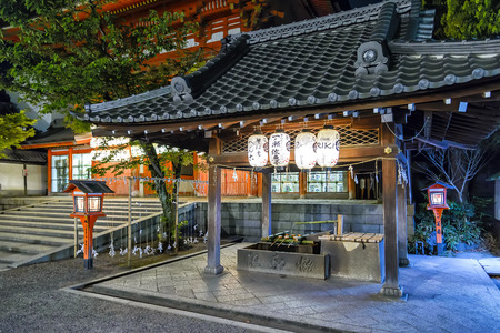 east end: Kyoto, Japan - April 23, 2014: View of Yasaka Shrine. Yasaka Shrine, once called Gion Shrine, is a Shinto shrine in the Gion District of Kyoto. Is situated at the east end of Shijo-dori.