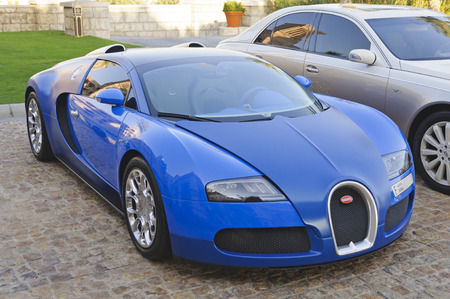 Dubai, UAE - January 08, 2012: View of a Bugatti Veyron supercar in front of Al Qasr Hotel. Veyron was named Car of the Decade and best car award 2000-2009 by the BBC television program Top Gear. Editorial