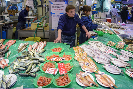 fish vendor: Kanazawa, Japan - April 14, 2014: A fish vendor in Omicho Market. Omicho Ichiba has been Kanazawas largest fresh food market since the Edo Period. Today, it is a busy network of covered streets.