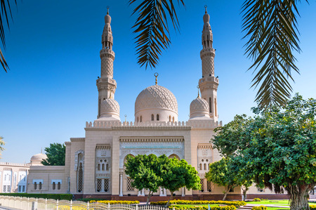 urban culture: Dubai, UAE - January 08, 2012: View of Jumeirah Mosque. This is a mosque in Dubai City and It is said that it is the most photographed mosque in all of Dubai. Organized tours are available for non-Muslims.