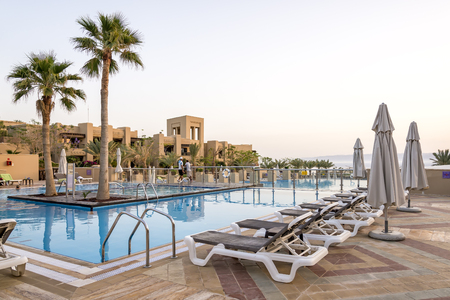 dead: Sweimeh, Jordan - April 07, 2015: View of Holiday Inn Resort Dead Sea swimming pool. Nestled on the beach, this resort is within 25 mi of Mount Nebo, St George Church, and Madaba Archaeological Park. Editorial