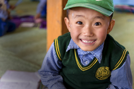 destitute: Leh, India - August 24, 2015: View of a smiling tibetan student in SOS Childrens Village school. SOS Childrens Village is an integrated educational community for destitute Tibetan children in exile. Editorial