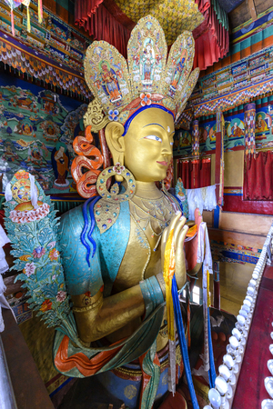 future buddha: Thikse, India - August 16, 2015: View of the huge staute depicting Maitreya in Thikse Monastery. Maitreya is regarded as a future Buddha of this world in Buddhist eschatology. Editorial