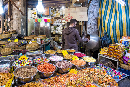 suq: Amman, Jordan - April 02, 2015: View of Souq Market in Amman downtown. A souq is an open-air marketplace or commercial quarter in Western Asian and North African cities. The equivalent term is bazaar.