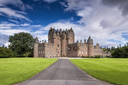 castle: Glamis, United Kingdom - August 17, 2014: View of Glamis Castle in Scotland. Glamis Castle is situated beside the village of Glamis in Angus. It is the home of the Countess of Strathmore and Kinghorne, and is open to public. Editorial