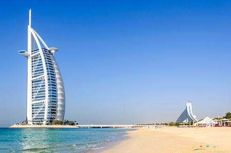 Dubai, United Arab Emirates - January 08, 2012: View of Burj Al Arab hotel from the Jumeirah beach. Burj Al Arab is one of the Dubai landmark, and one of the world's most luxurious hotels with 7 stars.