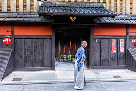 tea house: Kyoto, Japan - April 23, 2014: Old man in front of Ichiriki Chaya entrance in Gion district. Ichiriki Chaya is one of the most famous and historic ochaya (geisha tea house) in Kyoto Editorial
