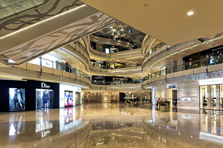 display advertising: Shanghai, China - August 16, 2011: View of Shanghai IFC Mall interior. IFC, located in Pudong area, is one of the foremost luxury shopping destinations in the world and offer the best luxury brand. Editorial