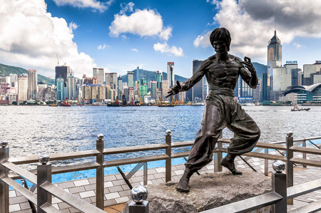 behalf: Hong Kong, China - August 22, 2011: The Bruce Lee memorial in Avenue of Stars. The memorial, a 2.5 metre bronze statue, was built on behalf of Bruce Lee, who died on 20 July 1973 at the age of 32. Editorial