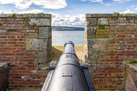 the jacobite: Fort George, United Kingdom - August 19, 2014: 18th Century cannon at Fort George military fortress. The fort was built to pacify the Scottish Highlands in the aftermath of the Jacobite rising of 1745 Editorial