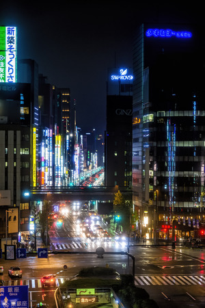 Tokyo, Japan - April 21, 2014: Night view of Chuo-dori. This is the main shopping street in the Ginza area. The street is home to many department stores, flagship brand shops, restaurants and cafes. Editorial
