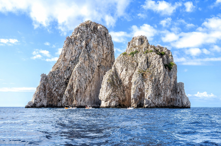 The faraglioni of Capri Island, Italy. Faraglioni are stacks, a coastal rock formation eroded by waves. They are found at the coasts of several regions and the most famous are off the island of Capri Stock Photo