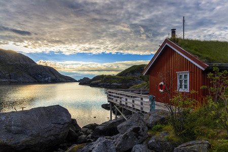 Sunrise in Nusfjord village, Norway. Nusfjord is one of the oldest and best preserved fishermen village of Lofoten islands. Currently is not inhabited permanently but rather a museum.