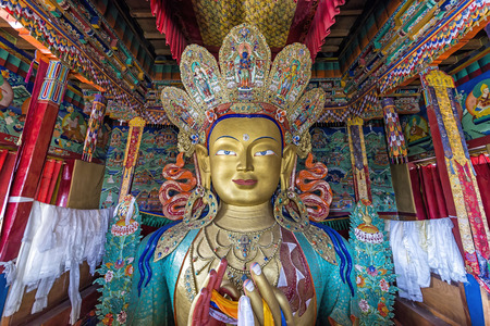 Thikse, India - August 16, 2015: View of the huge statue depicting Maitreya in Thikse Monastery. Maitreya is regarded as a future Buddha of this world in Buddhist eschatology