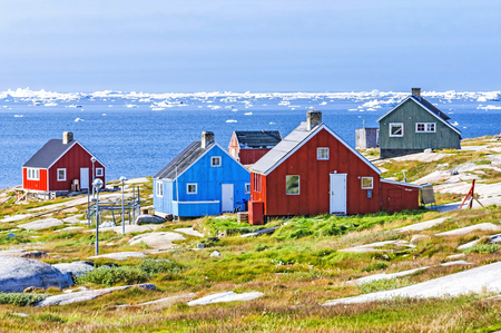 The colorful houses of Rodebay, Greenland. This settlement is located on a small peninsula jutting off the mainland into eastern Disko Bay, 22.5 km north of Ilulissat. It had 46 inhabitants in 2010 Stock Photo