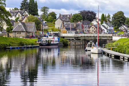 ness river: Fort Augustus, United Kingdom - August 19, 2014: The caledionan canal at the Loch Ness lake. The Canal connects the Scottish east coast at Inverness with the west coast at Corpach near Fort William Editorial