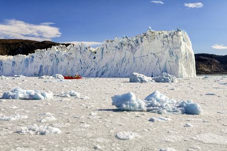 View of the Eqi Glacier in Greenland. Very few places in Greenland are beautiful as this glacier, at 70 km north of Ilulissat, in the Disco Bay. The Eqi is one of the most active glaciers in Greenland