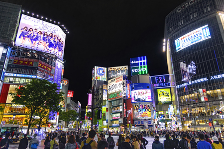 Tokyo, Japan - April 21, 2014: View of Shibuya district at night. Shibuya is known as one of the fashion centers of Japan, particularly for young people, and as a major nightlife area