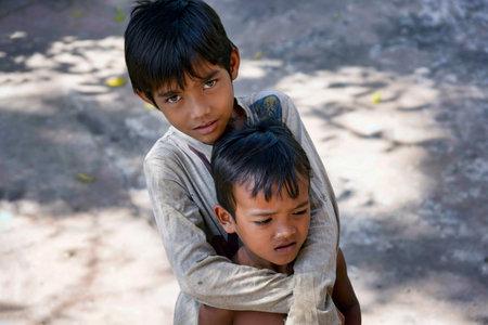 Lolei, Cambodia - January 01, 2017: Portrait of two unidentified boys met outside Wat Lolei Buddhist Temple