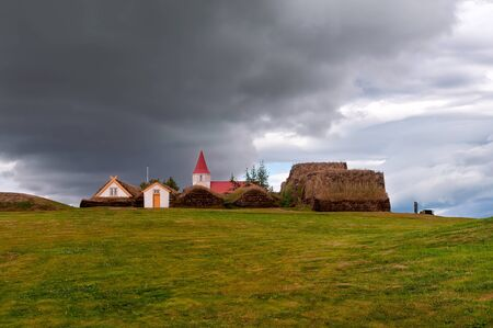 "The ancient village of Glumbaer in Iceland. Here an ancient farm has been preserved, inhabited until 1930. The farm is world famous for his ""turf houses"""