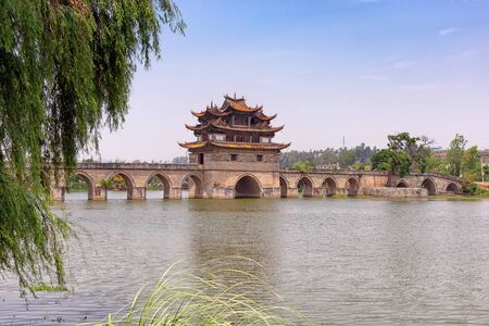 The Double Dragon bridge in Jianshui County, China. Constructed in 1800s with three towers and 17 archways is still hailed as a masterpiece of traditional Chinese bridge-making