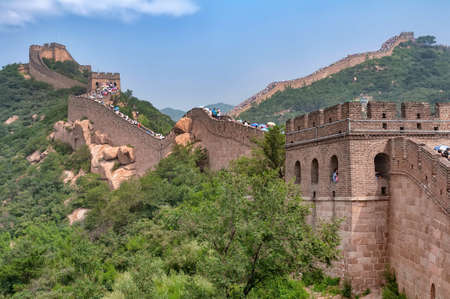 Badaling, China - August 9, 2011: View of the Great Wall crowded for chinese summer holidays. The Great Wall of China is the collective name of a series of fortification
