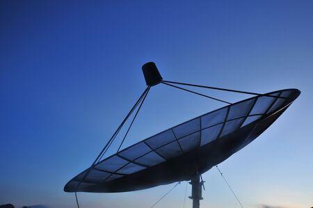 Satellite dish in morning sky  photo