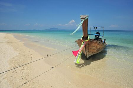 Boat in  Beach ,bamboo Island.krabi, South of Thailand photo