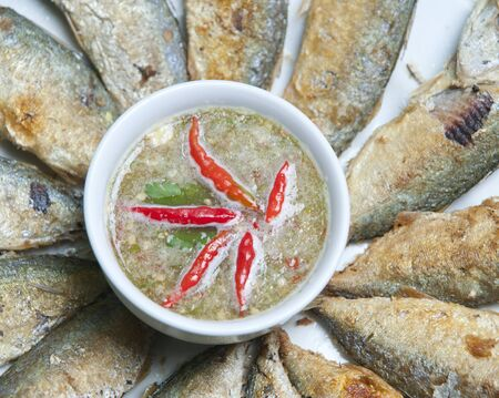 mackerel with thai hot and spicy seafood sauce mixed herb  photo