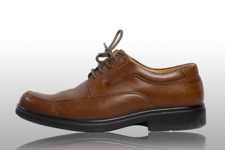 Pair of brown male classic shoes isolated on white background  photo