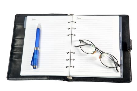 notebook or diary and pen isolated on white  photo