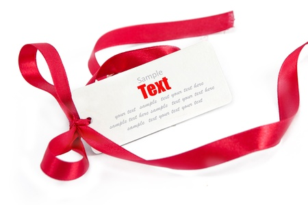 Shiny red ribbon bow on white background with copy space  Stock Photo