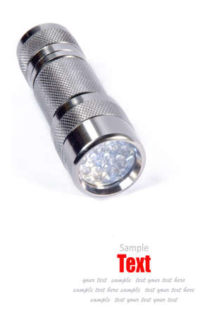 silver metal flashlight isolated on white background.  photo