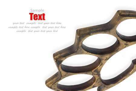 Photo of a pair of brass knuckles isolated on white  photo