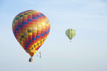 colorful hot air balloon in blue sky, with sky ideal as copy space Stock Photo