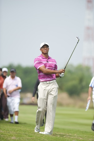 caddie: BANGKOK THAILAND - NOV 8 : Tiger Wood action in World Golf Salutes King Bhumibol at  Amata Spring Bangkok Thailand on Nov 8,2010  Editorial