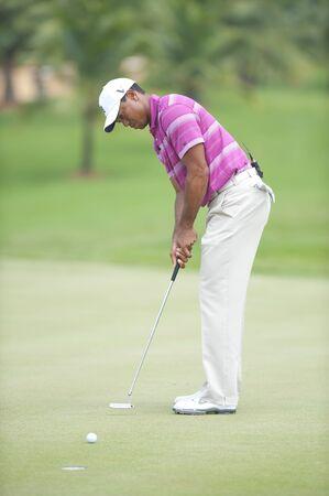 salutes: BANGKOK THAILAND - NOV 8 : Tiger Wood action in World Golf Salutes King Bhumibol at  Amata Spring Bangkok Thailand on Nov 8,2010  Editorial
