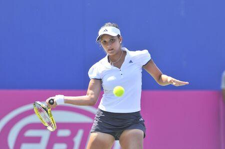battledore: NONTHABURI ,THAILAND - FEB 4 : India tennis player Sania Mirza during her Fed Cup, 2011 World Group Play-Off singles match vs. Noppawan Lertcheewakam,February 4, 2011 in Nonthaburi ,Thailand