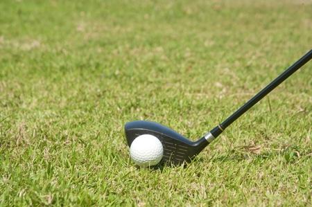 Playing golf. Golf club and ball. Preparing to shot Stock Photo - 8766942