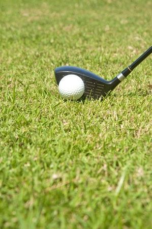 Playing golf. Golf club and ball. Preparing to shot Stock Photo - 8766943