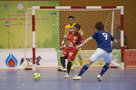 attacked: BANGKOK - DECEMBER 11 :, Unidentified players during a mens soccer match between Thailand vs Japan, Bangkok Futsal Super Match 2010.on DECEMBER 11 -12, 2010 in Bangkok, Thailand.  Editorial