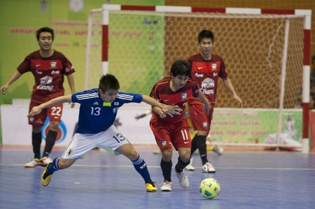 BANGKOK - DECEMBER 11 :, Unidentified players during a mens soccer match between Thailand vs Japan, Bangkok Futsal Super Match 2010.on DECEMBER 11 -12, 2010 in Bangkok, Thailand.