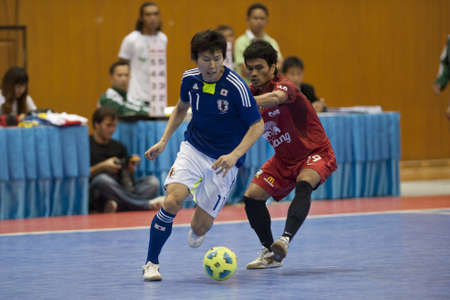 BANGKOK - DECEMBER 11 :, Unidentified players during a mens soccer match between Thailand vs Japan, Bangkok Futsal Super Match 2010.on DECEMBER 11 -12, 2010 in Bangkok, Thailand.