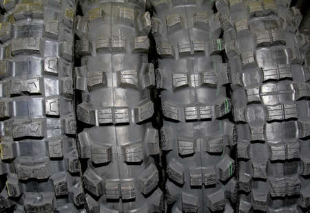 tires stacked up and isolated on white background - worms view  photo