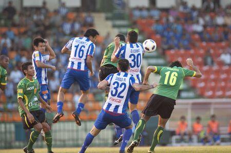 BANGKOK THAILAND- FEB 27: Thai Premier League (TPL) between Army Utd. (green) vs Sriracha Zusuki Fc (Blue) on February 27, 2011 at Army Stadium in Bangkok Thailand  Stock Photo - 8944844