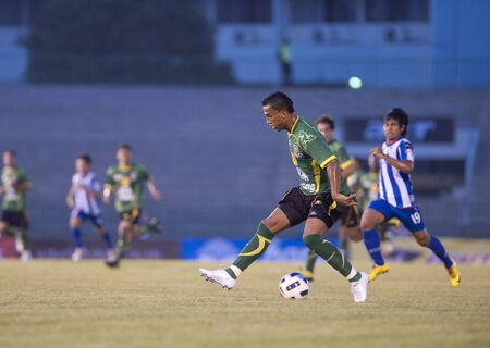 BANGKOK THAILAND- FEB 27: Thai Premier League (TPL) between Army Utd. (green) vs Sriracha Zusuki Fc (Blue) on February 27, 2011 at Army Stadium in Bangkok Thailand  Stock Photo - 8944840