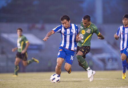 BANGKOK THAILAND- FEB 27: Thai Premier League (TPL) between Army Utd. (green) vs Sriracha Zusuki Fc (Blue) on February 27, 2011 at Army Stadium in Bangkok Thailand  Stock Photo - 8944855