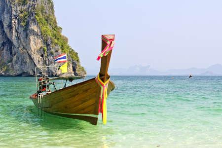 Tropical beach, traditional long tail boats, Andaman Sea, Thailand  photo